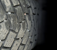 Tire closeup fade to black Stock Photography