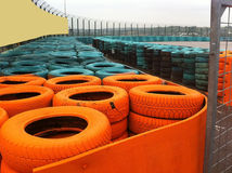 Tire Company. With Orange And Blue Tires In The Yard Royalty Free Stock Photo