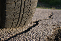 Tire And Cracked Asphalt Stock Photos