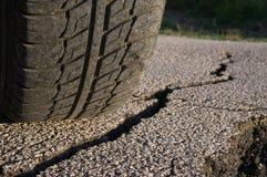 Tire And Cracked Asphalt Stock Photos
