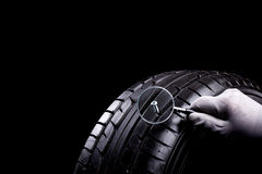 Tire damage. Car tires during service in the workshop royalty free stock image