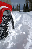 Tire in deep snow. Four wheel drive with chains in deep snow royalty free stock photos