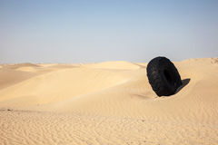 Tire in the desert Royalty Free Stock Image