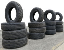 Tire Display. New tires for sale outdoor display. Horizontal. White background Stock Photos