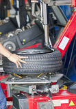 Tire Fitting Machine. Royalty Free Stock Photo