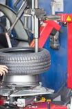 Tire Fitting Machine Stock Photo