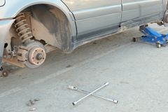Tire fitting. Part of an old car without a wheel. Repair of tires or rims. stock photos
