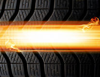 Tire and flames background Stock Images