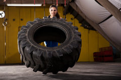Tire flip in a gym Royalty Free Stock Photography