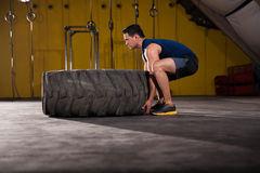 Tire flip in a gym Royalty Free Stock Photos