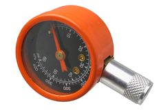 Tire Gauge. Orange tire pressure gauge isolated against white Stock Image