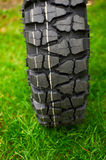 Tire at green grass Royalty Free Stock Photos
