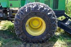 Tire on Green Log Skidder Stock Images