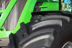 Tire on green tractor close up Royalty Free Stock Photo