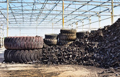 Tire industry. Close up of old used tires and shredded tire pile royalty free stock photography