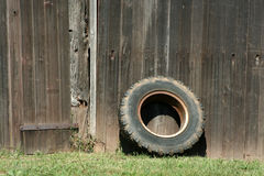 Tire Leaning On A Old Barn Royalty Free Stock Image