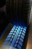 Tire with lit treads Stock Photo