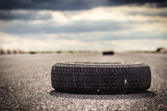 Tire. Lying on asphalt racetrack Royalty Free Stock Image
