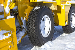 Tire machines for snow removal on Kamchatka Royalty Free Stock Photos