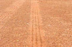 Tire mark in laterite. Background Royalty Free Stock Photography