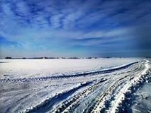 Tire markings in snow. Fields stock image