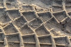 Tire marks in the sands of time stock photos