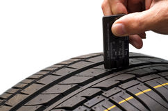 Tire measuring Royalty Free Stock Image