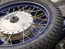 Tire motorcycle wheel with metal spokes Royalty Free Stock Photo