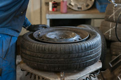 Tire mounting equipment in the workshop. Stock Photos