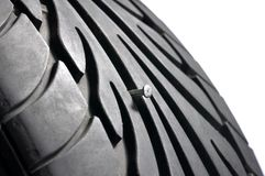 Tire with nail. Close up of tire with nail royalty free stock image