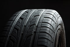 Tire. New tire, just bought , on an isolated dark background Royalty Free Stock Photos