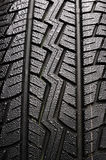 Tire. New tire with water droplets Royalty Free Stock Photo
