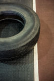Tire next to race track Stock Images
