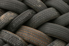 Tire patterns 2. Old automobile tires stacked in a pattern Royalty Free Stock Photo