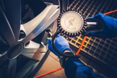 Tire Pressure Car Service Check. Checking Tire PSI. Auto Maintenance Stock Images