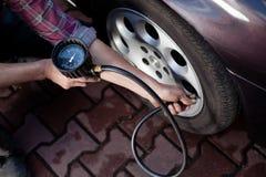 Tire pressure check Stock Photo