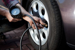 Tire pressure check Stock Photography