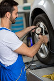 Tire pressure check Royalty Free Stock Photo