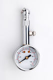 Tire-pressure gauge. On white background Royalty Free Stock Photos