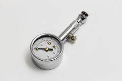 Tire pressure gauge  on white background Royalty Free Stock Photo