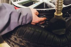 Tire pressure sensor installation, car, test procedure in a car-care center. royalty free stock photo