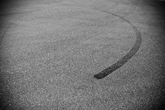 Tire print on the asphalt road Royalty Free Stock Photos
