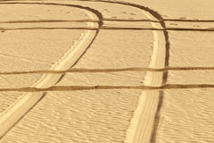 Tire prints in the desert Royalty Free Stock Photography