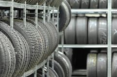 Tire rack. Lot of tires in garage Royalty Free Stock Photo