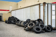 Tire Recycling Center. Recycling business with metal container and car tires beside it royalty free stock image