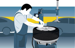 Tire repairman Stock Images