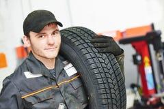 Tire repairman auto mechanic Stock Photography