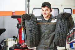 Tire repairman auto mechanic Stock Images
