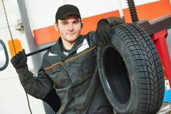 Tire repairman auto mechanic Stock Image
