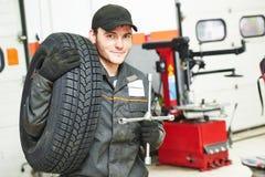 Tire repairman auto mechanic Royalty Free Stock Photo